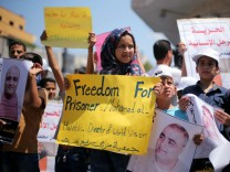Palestinian demonstrators take part in a protest in solidarity with Mohammad El Halabi, World Vision's manager of operations in Gaza, organised by foundations and societies benefiting from World Vision in Gaza City