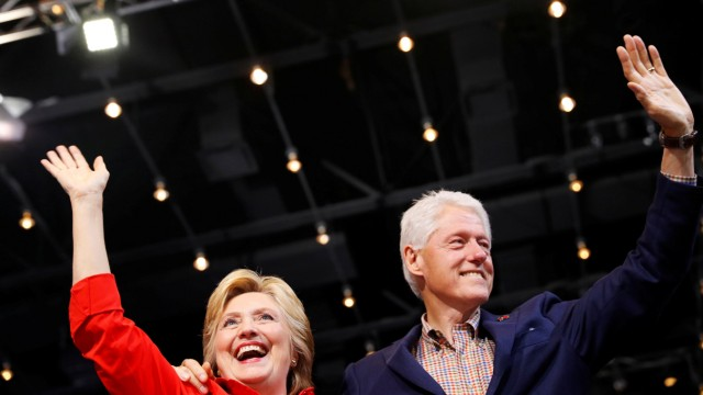 Democratic presidential candidate Hillary Clinton waves to the crowd with her husband, former president Bill Clinton at the David L. Lawrence Convention Center in Pittsburgh, Pennsylvania