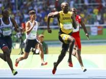 Athletics - Men's 100m Round 1