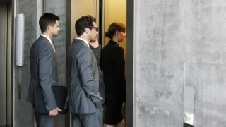 Group of businesspeople entering elevator model released property released PUBLICATIONxINxGERxSUIxAU