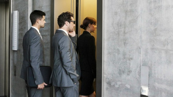 Group of businesspeople entering elevator model released property released PUBLICATIONxINxGERxSUIxAU