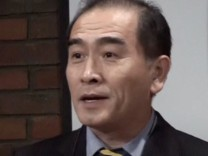 Still image of Thae Yong Ho, North KoreaÕs deputy ambassador in London, speaking on a podium in London
