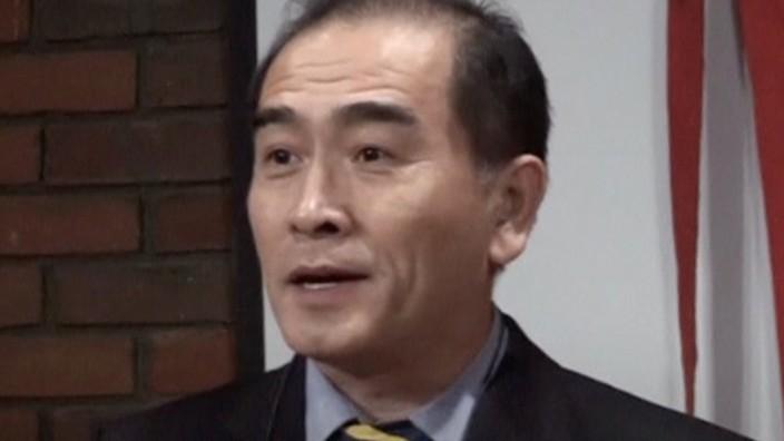 Still image of Thae Yong Ho, North KoreaÕs deputy ambassador in London, speaking on a podium in London