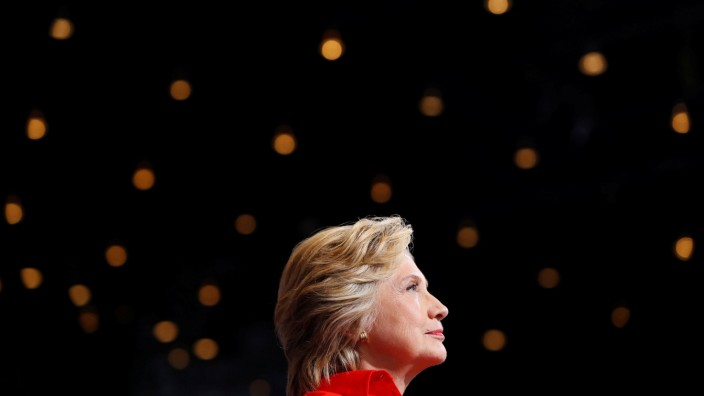 Democratic presidential candidate Hillary Clinton looks on as vice presidential candidate Senator Tim Kaine speaks at the David L. Lawrence Convention Center in Pittsburgh, Pennsylvania