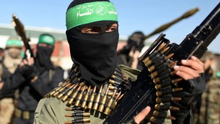 File photo of Palestinian members of the al-Qassam brigades standing guard as they wait for the arrival of Hamas chief Meshaal in the southern Gaza Strip