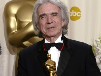 Arthur Hiller holds the Jean Hersholt Humanitarian Award that he received at the 74th annual Academy Awards in Hollywood