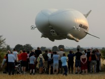The Airlander 10 hybrid airship makes its maiden flight at Cardington Airfield in Britain