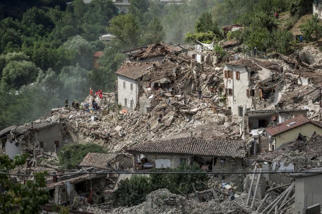 Rescuers work following an earthquake in Pescara del Tronto