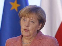 German Chancellor Merkel speaks during the news conference in Warsaw