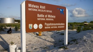 The Midway Atoll National Wildlife Refuge park sign is seen on Midway Atoll
