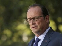 French President Hollande delivers a speech after a meeting with European social democratic leaders at the castle of La Celle Saint-Cloud, near Paris