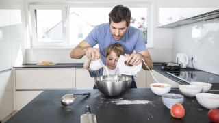 Father and son preparing waffle dough in kitchen model released Symbolfoto property released PUBLICA