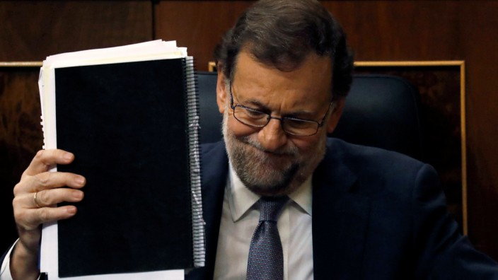 Rajoy reacts an investiture debate at parliament in Madrid