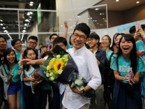 Nathan Law celebrates after winning a seat in the Legislative Council election, in Hong Kong, China