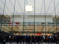 People line up outside an Apple store in Hangzhou