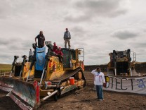 Protesters stand on heavy machinery after halting work on the Energy Transfer Partners Dakota Access oil pipeline near the Standing Rock Sioux reservation near Cannon Ball, North Dakota