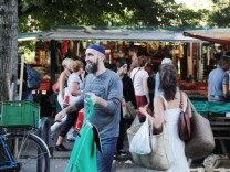 People visit a market in Berlin's Kreuzberg district