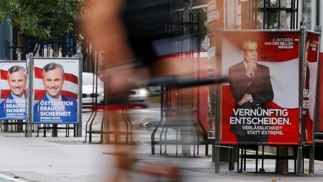 Presidential election campaign posters of Norbert Hofer and Alexander Van der Bellen are seen in Vienna
