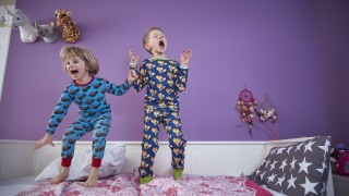 Brother and sister wearing pajamas romping around in children s room model released Symbolfoto prope