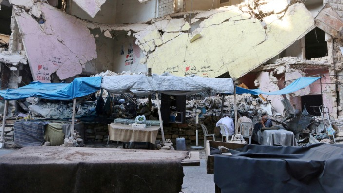 A file photo shows empty vegetable stalls in Aleppo's rebel-controlled Bustan al-Qasr neighbourhood due to a siege by Syrian pro-government forces that cut the supply lines into opposition-held areas of the city