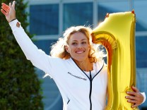 U.S. Open winner Angelique Kerber jumps after a news conference in Munich