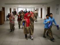 Students of Tevfik Ileri Imam Hatip School walk along a corridor as they leave their classroom for a break in Ankara