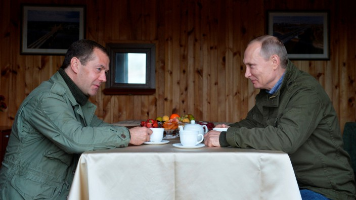 Russian President Putin and Prime Minister Medvedev are seen during their meeting on Lipno Island in Novgorod region, Russia