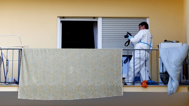 Police photographes a flat where the 27-year-old Syrian suspect lived, after an explosion in Ansbach near Nuremberg