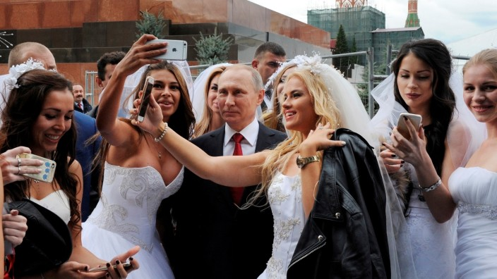 Russian President Vladimir Putin poses for a photo during the celebrations for the City Day at Red Square in Moscow