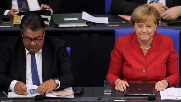 German Chancellor Angela Merkel and German Economy Minister Sigmar Gabriel attend a meeting at the lower house of parliament Bundestag on 2017 budget in Berlin