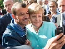 Bundeskanzlerin Merkel besucht Flüchtlingsunterkunft