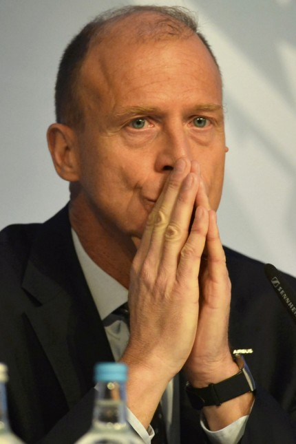 Airbus Group Chief Executive Tom Enders listens during a news conference on the aerospace group's annual results, in London