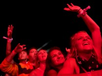 Revelers dance as Coldplay performs during the fifth annual Made in America Music Festival in Philadelphia, Pennsylvania
