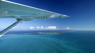 Aerial view of Exuma with aeroplane wing part of the chain of 365 islands that form the Bahamas P