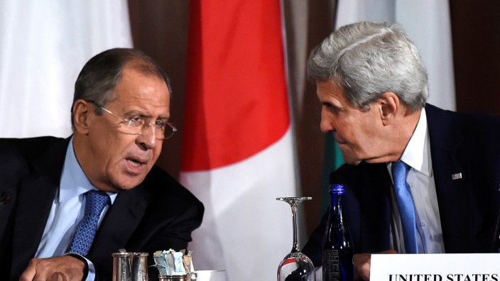 U.S. Secretary of State John Kerry speaks with Russian Foreign Minister Sergei Lavrov during the International Syria Support Group meeting at the Palace Hotel in Manhattan