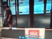 An image taken from security video of the gunman who opened fire in the Cascade Mall in Burlington