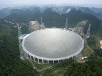The world's largest radio telescope named 'FAST' is seen before being put into use on Sunday, in Pingtang county, Guizhou province, China