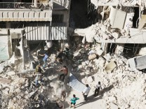 People dig in the rubble in an ongoing search for survivors at a site hit previously by an airstrike in the rebel-held Tariq al-Bab neighborhood of Aleppo