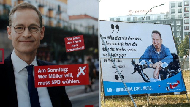 Election posters of top candidate of Social Democratic Party and Mayor of Berlin Mueller and top candidate of the anti-immigration party Alternative for Germany Pazderski for local city elections are pictured in Berlin