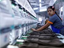A labourer works at a garment factory in Bangkok