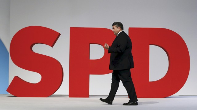 German Economy Minister and Leader of the SPD Sigmar Gabriel walks on the podium during party congress in Berlin