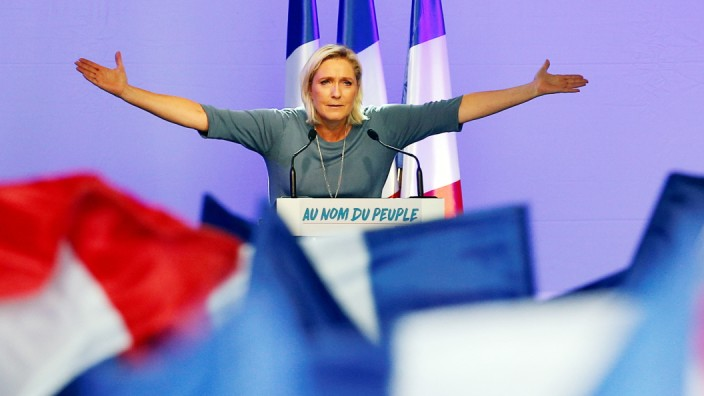 Marine Le Pen, French National Front (FN) political party leader, gestures during an FN political rally in Frejus