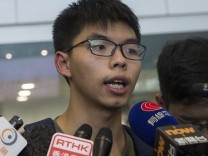 Hong Kong student activist Joshua Wong arrives to Hong Kong after
