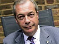Former UKIP leader Nigel Farage poses for a picture during an interview with Reuters at his Westminster office in London