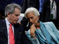 International Monetary Fund (IMF) Managing Director Christine Lagarde (R) chats with David Lipton, IMF first deputy managing director