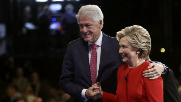 Democratic U.S. presidential nominee Hillary Clinton holds hands with Bill Clinton after the conclusion the first debate with Republican U.S. presidential nominee Donald Trump at Hofstra University in Hempstead