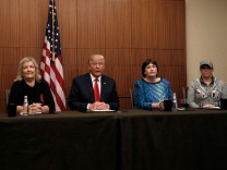 Republican presidential nominee Donald Trump sits with Paula Jones, Kathy Shelton, Juanita Broaddrick and Kathleen Wiley in a hotel conference room in St Louis, Missouri