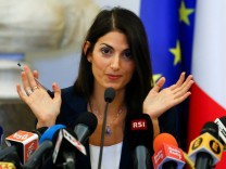 Rome's new mayor Raggi talks during a news conference in Rome