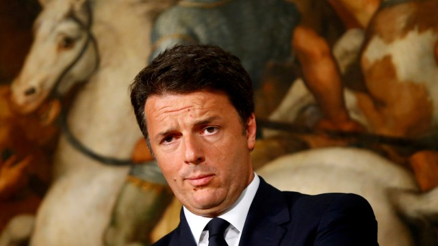 Italy Prime Minister Matteo Renzi looks on during a news conference at Chigi Palace in Rome