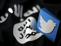 An illustration picture of a 3D printed logo of Twitter and an Islamic State flag